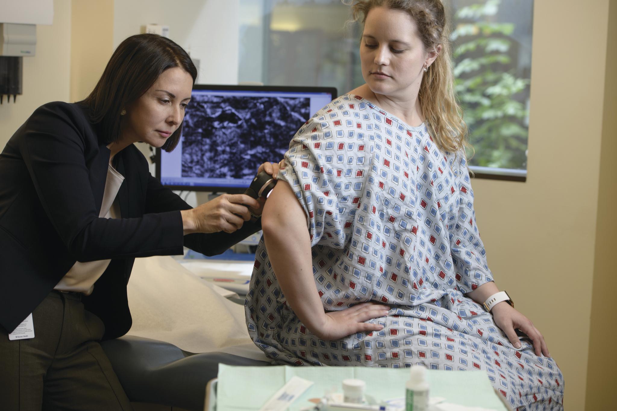 Dr. Clara Curiel examining a patient.